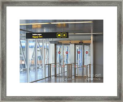 Sign Leading To Baggage Claim Framed Print by Jaak Nilson