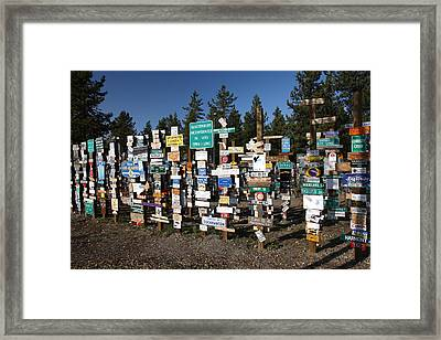 Sign Posts Forest In Watson Lake Yukon Framed Print by Mark Duffy