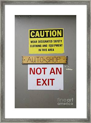 Signs On Workplace Door Framed Print by Roberto Westbrook