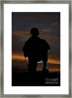 Silhouette Of A U.s. Marine In Uniform Framed Print by Terry Moore