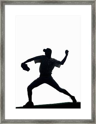 Silhouette Of Baseball Pitcher About To Pitch Framed Print by PM Images