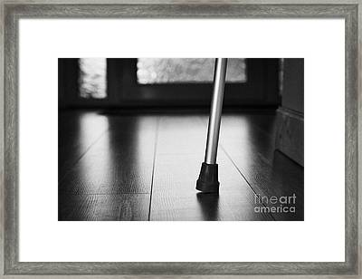 Single Crutch Leg Leaning Against A Wall In A House In The Uk Framed Print by Joe Fox