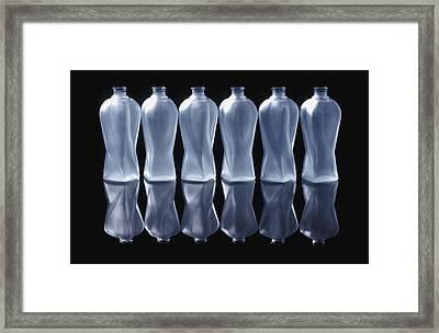 Six Glass Bottles Framed Print by David Chapman