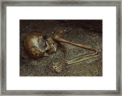 Skeleton Of Woman Buried In Volcanic Framed Print by Jonathan Blair