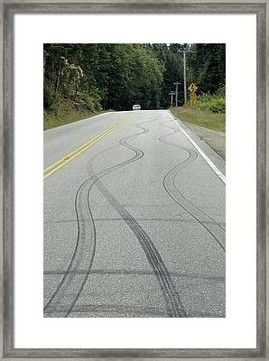 Skid Marks On A Road Framed Print by Alan Sirulnikoff