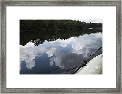 Sky And Clouds Reflected In River Framed Print by Roberto Westbrook