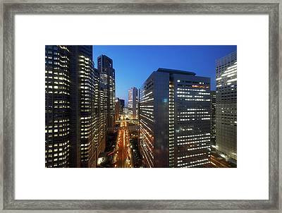 Skyscrapers In Commercial District Of Tokyo Framed Print by Vladimir Zakharov