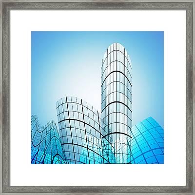 Skyscrapers In The City Framed Print by Setsiri Silapasuwanchai