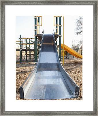 Slide And Playground Equipment Framed Print by Thom Gourley/Flatbread Images, LLC