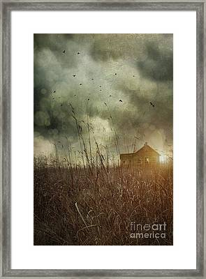 Small Abandoned Farm House With Storm Clouds In Field Framed Print by Sandra Cunningham