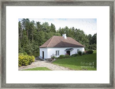 Small Lakeside Building Framed Print by Jaak Nilson