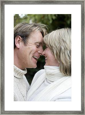 Smiling Couple Embracing Framed Print by Ian Boddy
