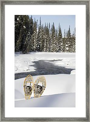 Snowshoes By Snowy Lake Lake Louise Framed Print by Michael Interisano