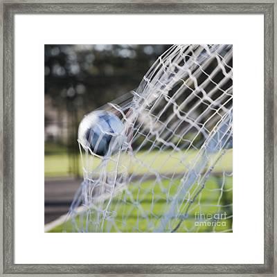 Soccer Ball In Goal Netting Framed Print by Jetta Productions, Inc