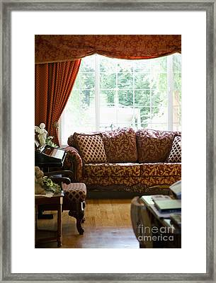 Sofa In Living Room Framed Print by Andersen Ross
