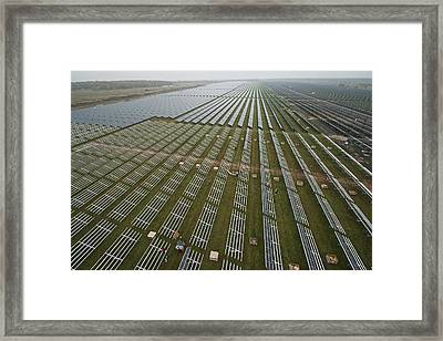 Solar Panels On Brackets Arrayed Framed Print by Michael Melford
