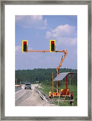Solar-powered Traffic Lights Framed Print by Alan Sirulnikoff
