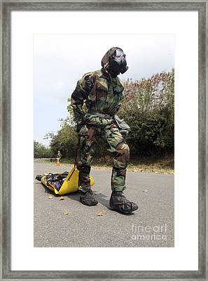 Soldier Drags A Simulated Attack Victim Framed Print by Stocktrek Images