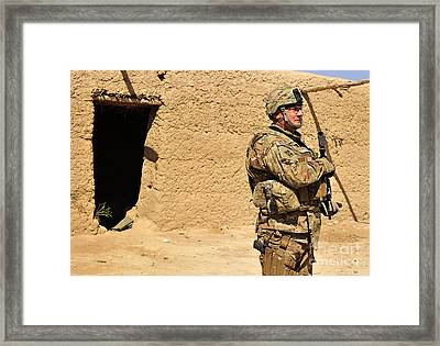 Soldier Stands Guard During A Routine Framed Print by Stocktrek Images