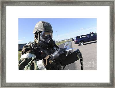 Soldier Uses An M256 Kit To Identify Framed Print by Stocktrek Images