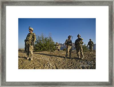 Soldiers Discuss A Strategic Plan Framed Print by Stocktrek Images