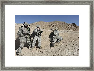 Soldiers Evaluate A Combat Scenario Framed Print by Stocktrek Images