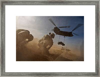 Soldiers In The Dust Of A Chinook Framed Print by Everett