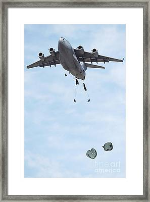 Soldiers Jump From A C-17 Globemaster Framed Print by Stocktrek Images