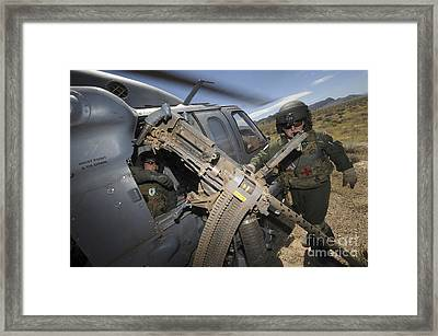 Soldiers Prepare To Reload A .50 Framed Print by Stocktrek Images