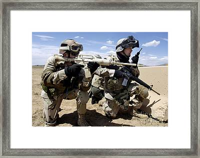 Soldiers Respond To A Threat Framed Print by Stocktrek Images