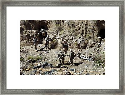 Soldiers Search Caves Near Kahrkia Framed Print by Stocktrek Images