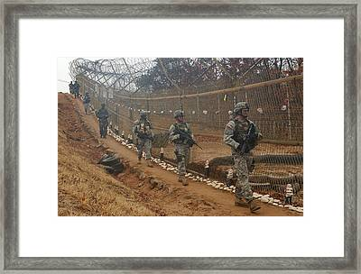 South Korean And Us Soldiers Patrol Framed Print by Everett