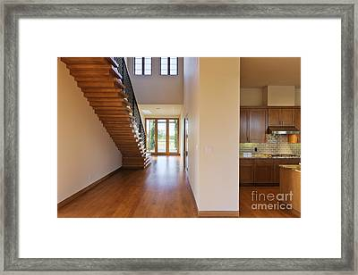 Spacious Hallway Showing A Staircase And Modern Kitchen Framed Print by Jeremy Woodhouse