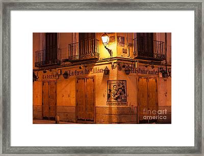 Spanish Taberna Framed Print by John Greim
