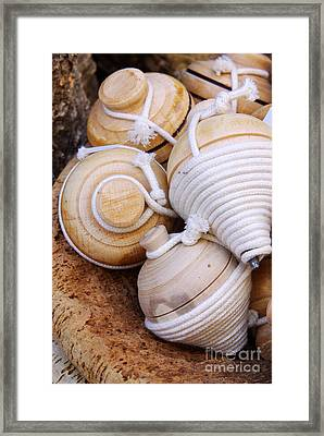 Spinning Tops Framed Print by Carlos Caetano