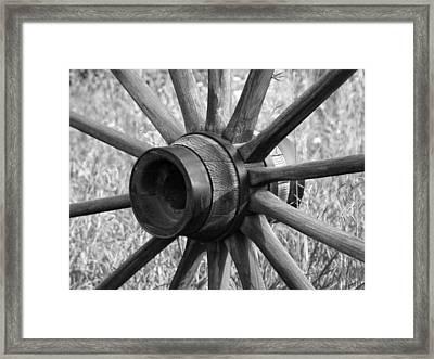 Spokes Framed Print by Ernie Echols