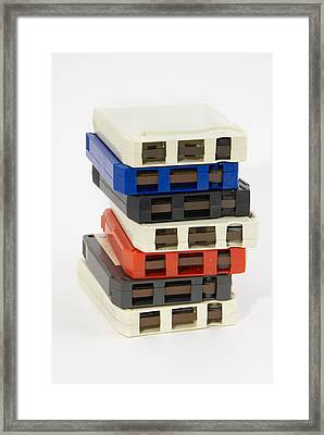 Stack Of 8-track Tapes From The Seventies Framed Print by David McGlynn