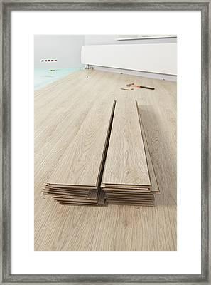 Stack Of Laminate Flooring Planks. Wood Framed Print by Magomed Magomedagaev