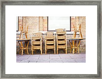 Stacked Chairs Framed Print by Tom Gowanlock