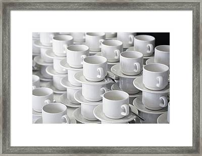 Stacks Of Cups And Saucers Framed Print by Tobias Titz