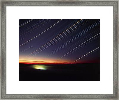 Star Trails Over Queen Charlotte City, Canada Framed Print by David Nunuk