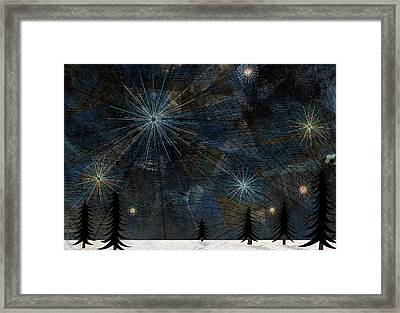 Stars Glistening In The Sky Above Pine Trees And Snow On The Ground Framed Print by Jutta Kuss