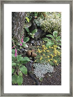 Statue Of A Duck And Terracotta Pots Framed Print by Archie Young