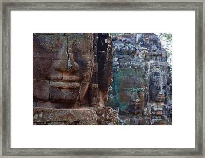 Stone Heads At Bayon Temple Framed Print by Carson Ganci