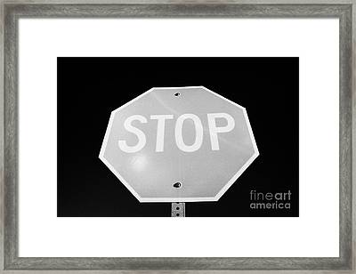 Stop Sign Against Blue Sky In North Dakota Usa United States Of America Framed Print by Joe Fox