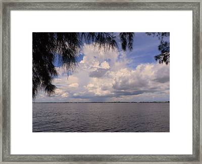Storm Across The River Framed Print by Rosalie Scanlon