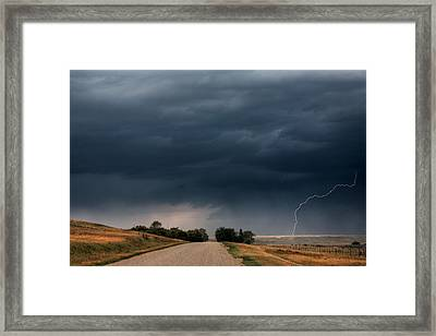 Storm Clouds And Lightning Along A Saskatchewan Country Road Framed Print by Mark Duffy