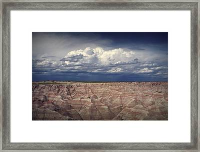 Storm Clouds Over The Badlands National Park Framed Print by Randall Nyhof