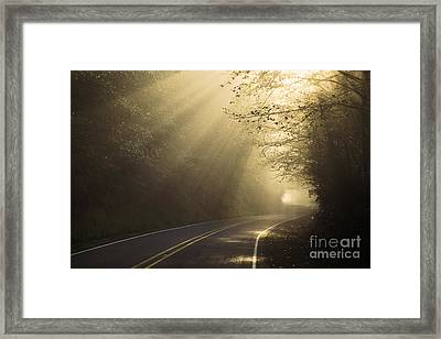 Sun Rays On Road Framed Print by Ron Sanford and Photo Researchers