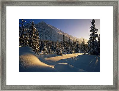 Sun Setting Behind Trees And Mountain Framed Print by Mike Grandmailson